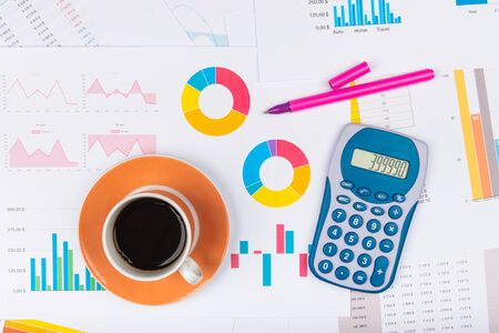 Business report. Cup of coffee on document. Accounting. Фото со стока