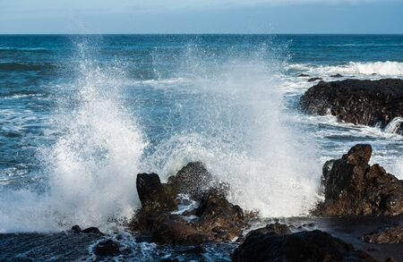 Waves breaking on the rocks. Ocean in Tenerife Фото со стока