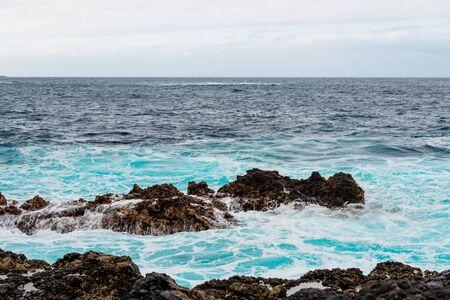 Waves and water of coast of Garachico  Фото со стока