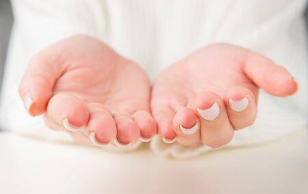 Open palms of a young woman Фото со стока