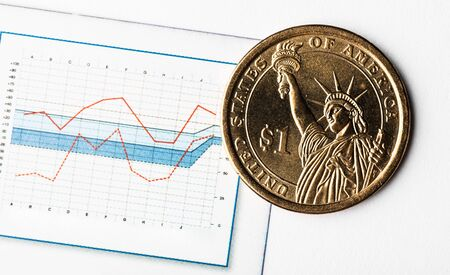 ne dollar coin on fluctuating graph. Rate of the us dollar (shallow DOF)