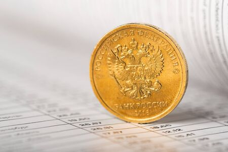 One ruble coin on a summary table (shallow DOF) Фото со стока