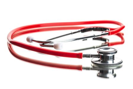 close up view of red stethoscope on white Фото со стока - 134116413