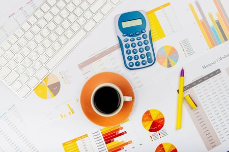 Business report. Cup of coffee on document. Accounting. Фото со стока - 134116441