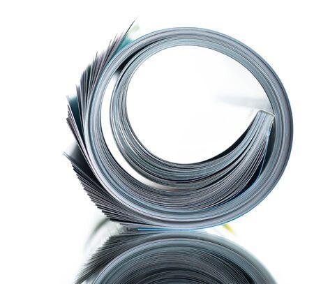 roll of magazine on white Фото со стока - 134116524