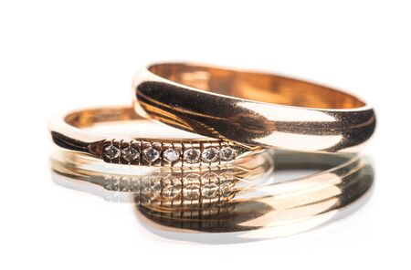 wedding rings on white background with reflection