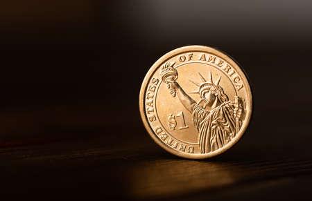 One dollar coin on desk