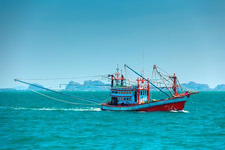 the sunken: Fishing boat in the open sea. Krabi, Thailand. Stock Photo