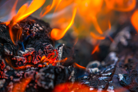 Burning and glowing charcoal with a hot flame in the background. Coal for BBQ Party, Grill Meat