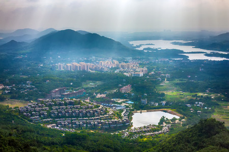 A city in a tropical forest by the lake. Yanoda Rain Forest. Hainan, China.