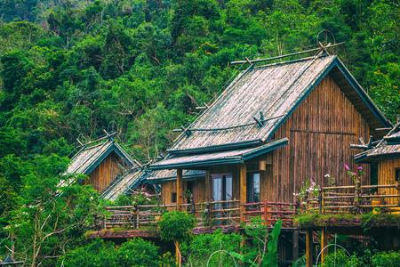 A wooden bamboo house in a rainforest. Sanya Li and Miao Village. Hainan, China.