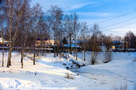 Children walk on thin ice on the river. Winter Russia, Uglich.