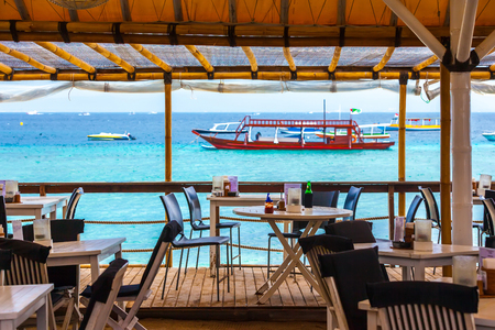 cafe on the background of azure sea. Gili Trawangan, Indonesia. Stok Fotoğraf