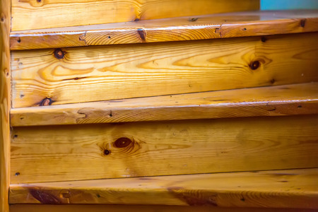 Lacquered Stair Steps Made Of Pine Boards Closeup. Fragment Of The Wood  Spiral Staircase Closeup