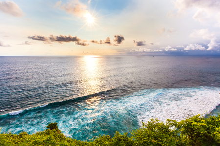 Bright light of the sun. Fantastic scenic landscape sunset from Pura Uluwatu cliff, Bali, Indonesia.