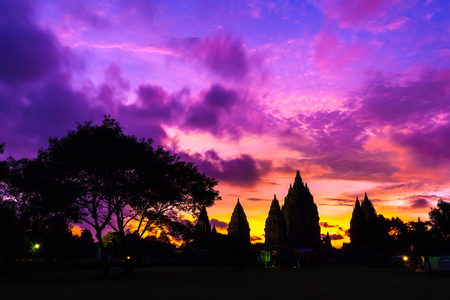 Silhouette of a temple complex against a colorfull red orange purple sky after sunset. Candi Prambanan Hindu Temple, Yogyakarta, Jawa, Indonesia.