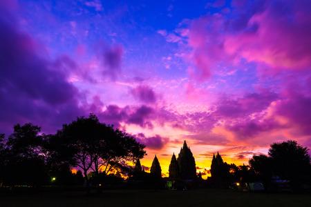 Silhouette of a temple complex against a beautiful red orange purple sky after sunset. Candi Prambanan Hindu Temple, Yogyakarta, Jawa, Indonesia. Stock Photo
