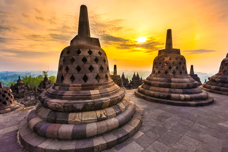 Taman Lumbini park from the height of the temple complex Candi Borobudur at sunrise in the fog. Candi Borobudur, Yogyakarta, Jawa, Indonesia.