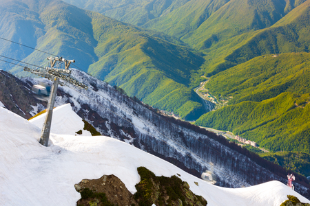 Lift support of the cable car on the mountain view. Ski Resort at Caucasus Mountains, Rosa Peak, Sochi, Russia. Stock Photo