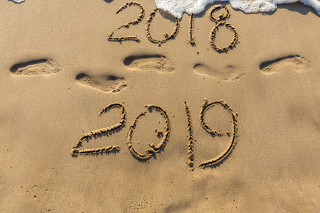 Concept of Happy New Year 2019 Wave water covering digits inscription. Meet at a tropical resort in Thailand. Stock Photo