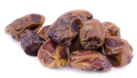 date fruit: Dried date fruit on a white background Stock Photo