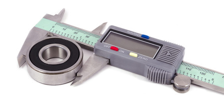 Bearing and electronis caliper on a white background