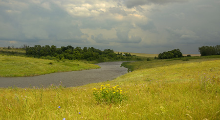 Cloudy summer landscape.River Krasivaya Mecha in Tula region, Russia Stock Photo