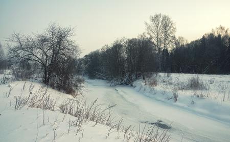 frozen river: Winter scene with frozen river