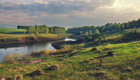 Sunny landscape with river Stock Photo