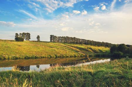Sunny summer landscape.River Krasivaya Mecha in Tula region, Russia.Sunset. Stock Photo