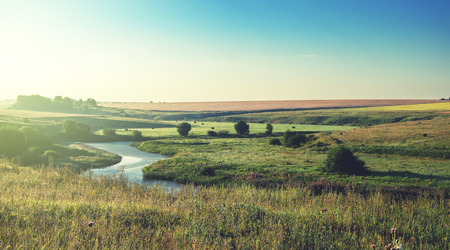 Sunny summer landscape.River Upa in Tula region, Russia.Meadows and fields at sunrise.Beautiful view.