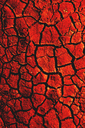 Abstract background of red cracked land Stock Photo