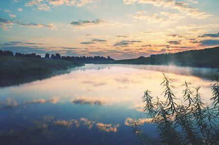 Foggy summer landscape.Twilight.Misty morning.River Krasivaya Mecha in Tula region, Russia.Sunrise.Calm.
