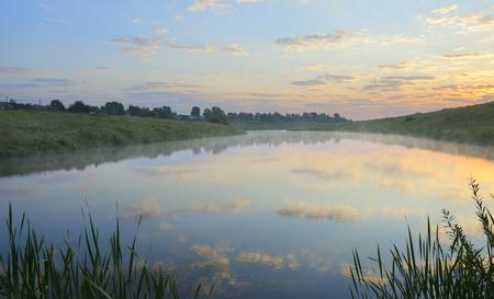 Foggy summer landscape.Rising sun.Serene morning.Calm.River Krasivaya Mecha in Tula region, Russia.