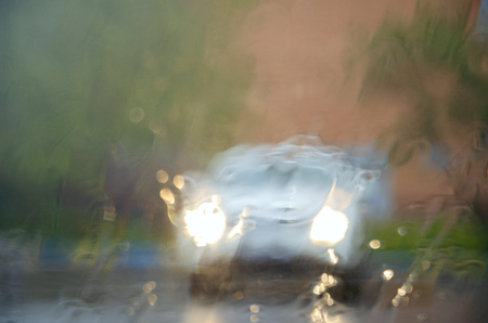 Adverse driving conditions. Heavy rain. View through car windshield.