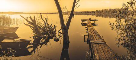 Landscape with wooden bridge and boats Foto de archivo