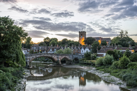 kent: View to Aylesford village in Kent, England with medieval bridge and church