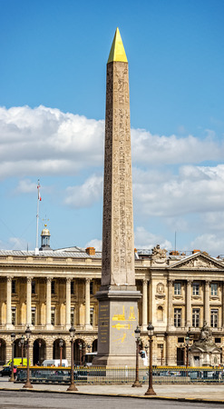 concorde: Luxor obelisk at place de la Concorde in Paris, France. The place was designed in 1755 and now is the largest public square in Paris. In the center of place is placed giant Egyptian obelisk decorated with hieroglyphics exalting the reign of the pharaoh Ra Editorial
