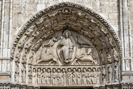 Chartres, France - April 19, 2013: Central tympanum of the Royal portal at Cathedral Our Lady of Chartres, France - one of the finest examples of French Gothic architecture, constructed during the 13th century.