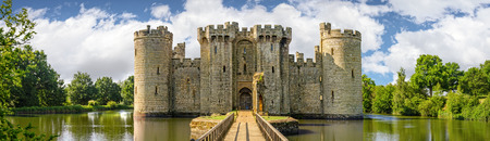 Sussex, United Kingdom - July 9, 2013: Moated castle Bodiam near Robertsbridge in East Sussex, England  was built in 1385 to defend the area against French invasion during the Hundred Years War.