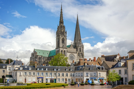 Chartres, France - April 19, 2013: A view to Cathedral Our Lady of Chartres from central place of city. Cathedral constructed during the 13th century and is fine example of French Gothic architecture.