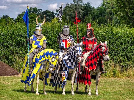 jousting: Hever, United Kingdom - July 28, 2013: Three knights are ready for tournament re-enactment at jousting event close to Hever Castle in Kent, England Editorial