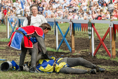 jousting: Hever, United Kingdom - July 28, 2013: First aid to horseman at jousting event at Hever Castle in Kent, England Editorial