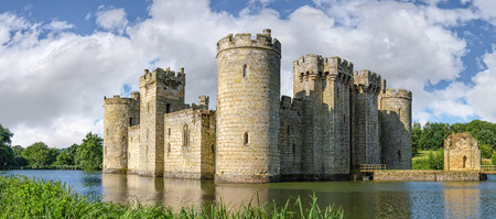 castle tower: Sussex, United Kingdom - July 9, 2013: Moated castle Bodiam near Robertsbridge in East Sussex, England  was built in 1385 to defend the area against French invasion during the Hundred Years War.