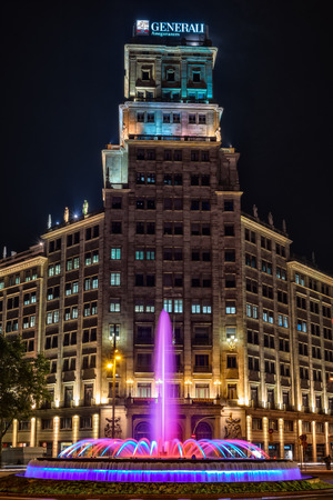 josep: Barcelona, Spain - September 24, 2015: Passeig de Gracia Fountain as seen at night on 24th of September, 2015. Fountain was designed by architect Josep Soteras and was built in 1952. Editorial