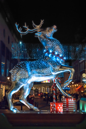 covent: London, United Kingdom - December 29, 2014: Silver reindeer decoration at Covent Garden as seen at night on 29th of December, 2014.