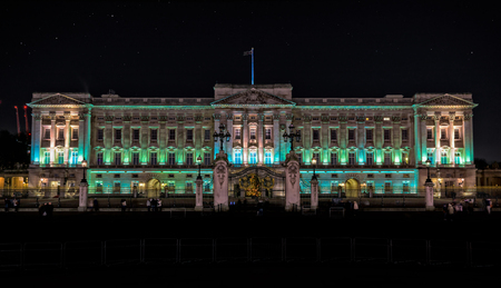 buckingham palace: London, United Kingdom - December 24, 2014: Buckingham Palace in london at night. Palace has served as the official London residence of British royal family since 1837.