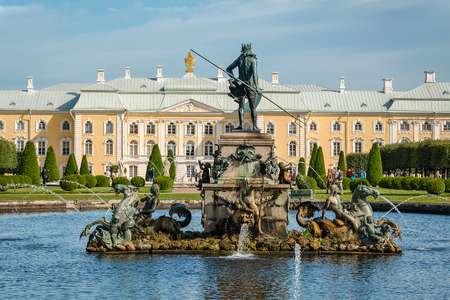 petergof: Petergof, St Petersburg, Russia - September 1, 2012: View from south to Neptune fountain and Grand Petergof Palace on background. Unidentified tourists present on picture.