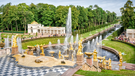 petergof: Petergof, St Petersburg, Russia - September 1, 2012: View from Grand Petergof Palace to Lower park with fountains, golden statues and channel. Unidentified tourists present on picture.