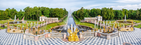 petergof: Petergof, St Petersburg, Russia - September 1, 2012: Panoramic view from Grand Petergof Palace to Lower park with fountains, golden statues and channel. Unidentified tourists present on picture.